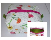 Floral boxy pouch with green liner and tabs, sock knitting project bag