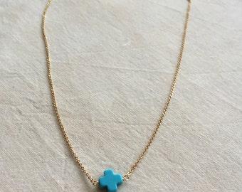 Tiny turquoise cross