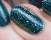 """Nail polish - """"Jungle District"""" silver holographic glitter in a dark teal base"""