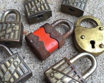 Seven Vintage Suitcase Locks