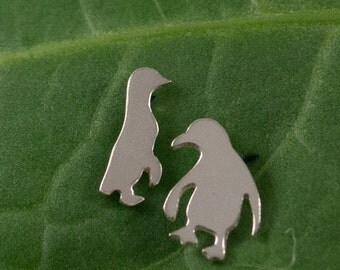 Silver Penguin earrings: A pair of Penguin shaped sterling silver earrings.