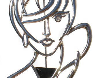 80s Vintage Jewelry Figural Brooch as Silver Woman with Rhinestone Eye and Black Triangle Signed JJ Jonette Jewelry Co