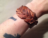 Leather feather cuff bracelet