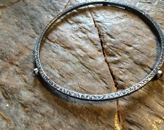 Pattern bangle with 3 bezel set onyx stones