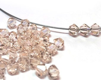 Swarovski Crystal Bicone Beads Silk 4mm (24)