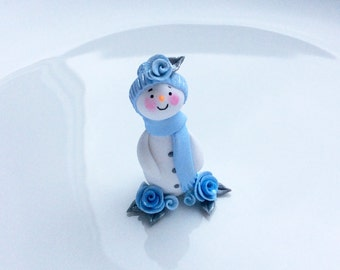 Miniature snowman Christmas ornament in pale blue handmade from polymer clay