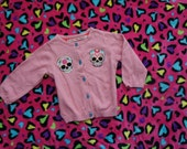 Olivia Paige - Rockabilly Sugar skulls La Muerte Tatttoo Pin up Little Girls pink cardigan sweater with sugar skull buttons
