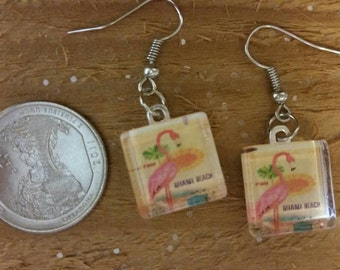 Glass and resin dangly flamingo earrings