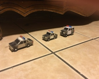 Three police cruisers