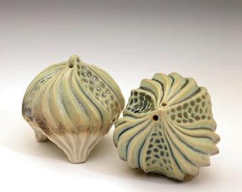 Carved porcelain urchin salt & pepper shaker set in green, tan and white
