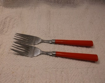2 mid century stainless steel forks - lipstick red acrylic (?) handles