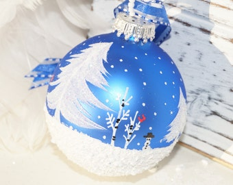 Glass Christmas Ornament, Hand Painted Cardinals N Snowman - White Pines, Aspen, Snow Scene, and Falling snow, on a Blue Christmas Ornament