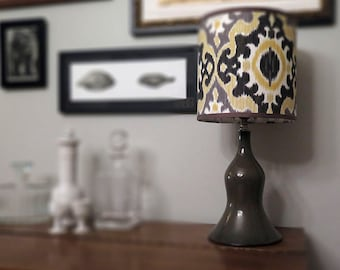 Wheel-thrown ceramic lamp with ikat shade