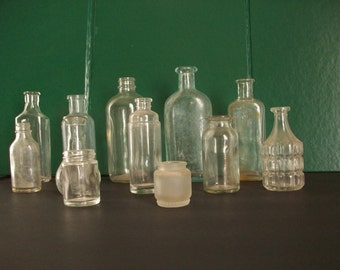 a collection of 12 vintage bottles for decor . old glass bottles . vintage glass bottles for wedding decor . instant collection of bottles