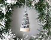Trimmed Bottle Brush Christmas Tree Ornament on Birch