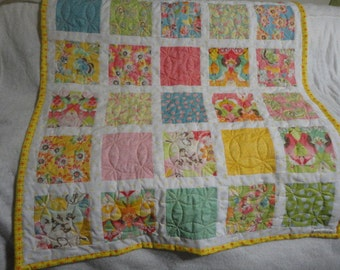 Spring colored baby Quilt is machine quilted and machine pieced