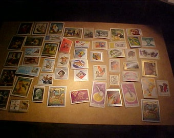 124 lot stamps new and used Magyar Rwandaise Nicaragua  Romania vintage 90s