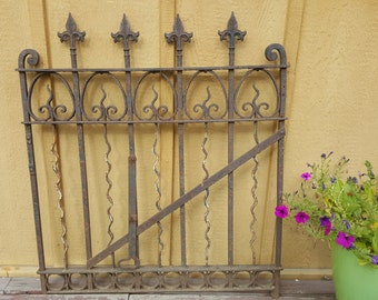 Antique hand forged iron gate with stunning detail