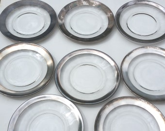 Set of 8 small Dorothy Thorpe plates. Great condition!