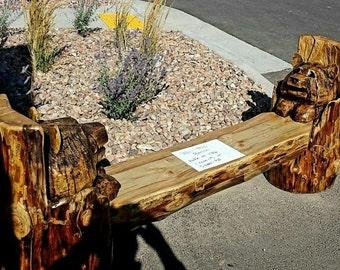 Chainsaw Bear log bench.  Bear cubs