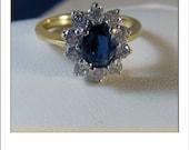 HOLDING --Vintage 18k 2 CT Sapphire Diamond Halo Engagement Ring - Princess Diana Style