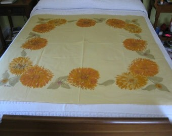 Vera square cotton tablecloth in shades of orange and tan
