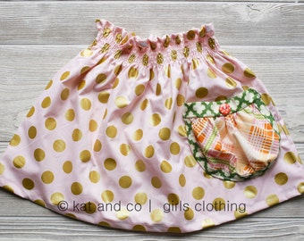 Girls gold dot pocket skirt with shirred waist and pocket.    Custom made sizes 3 months to 12 years.