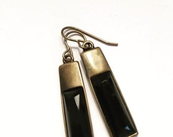 Brass Earrings with black center.