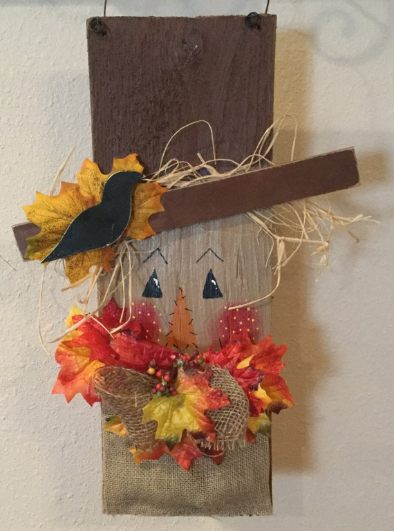Painted Scarecrow Face On Wood