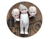 RESERVED.......3 vintage antique doll heads and bodies, doll parts, dug up, frozen charlotte, kewpie doll, googly