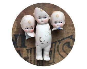 3 vintage antique doll heads and bodies, doll parts, dug up, frozen charlotte, kewpie doll, googly, porcelain head, from Elizabeth Rosen