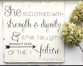 She is clothed with strength and dignity and she laughs without fear of the future. Proverbs 31:25. Reclaimed barn wood sign