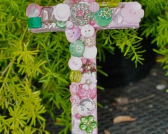 Trinket covered cross