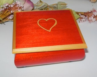 Vintage Reuge music box red with heart on box