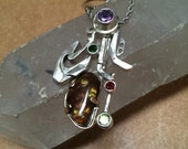 """Pendent fire agate """" voyager"""" by me Irie G."""