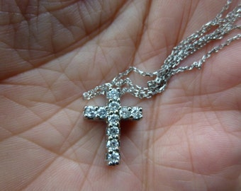 White gold diamond cross with 45 points of diamonds with a 18 inch gold chain