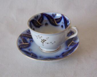 Antique Flow Blue Tea Cup and Sauer