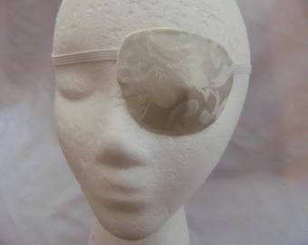 "Woman's handmade eye patch, ""White Floral""/eye care/ vision aid/ cataract aid/ eye treatment/health & beauty/ eye wear art/ high fashion"