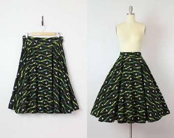 vintage 50s skirt / 1950s cotton felt circle skirt / black green skirt / graphic print skirt / atomic print skirt
