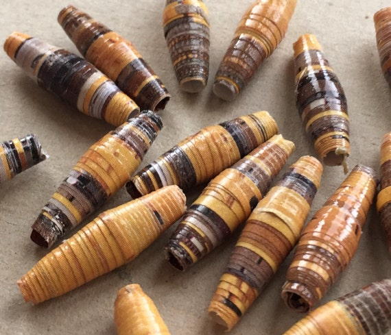 paper beads of golden honey yellow and shades of brown--lot of 8