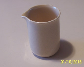 Franciscan Cream Pitcher ( soft yellow with speckles )