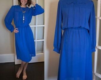 Colbalt Blue Long Sleeved Floral Applique Dress size Small / Medium
