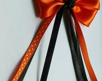 Medium Orange Bow with Shimmery Black and Orange Polka Dot Flowing Ribbons