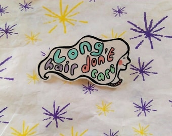 long hair don't care art pin badge