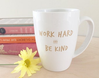 SALE! Work Hard and Be Kind 14 oz Mug – Designed by Sara Moore (White with Gold Lettering)