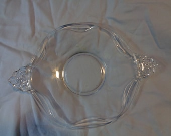 Vintage elegant pressed glass candy tray with lovely handles and swirled edging