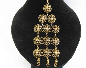 vintage jewelry, bib necklace, brass filigree motifs, 1960's
