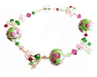 Bright green with pink and red flower lampwork bead bracelet,  ruby red, green and pink Swarovski Crystals, Sterling Silver, magnetic clasp