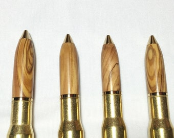 Even more 50 Cal machine gun brass cartridge pens turned top of various woods, great if you like big guns!  Cool Groomsman gifts!