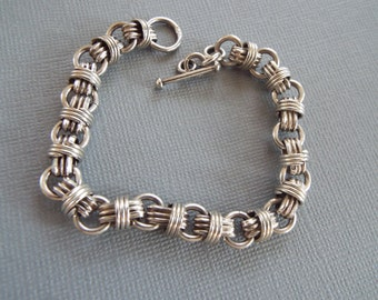 heavy sterling silver double link knotted  charm  bracelet 25.4 grams